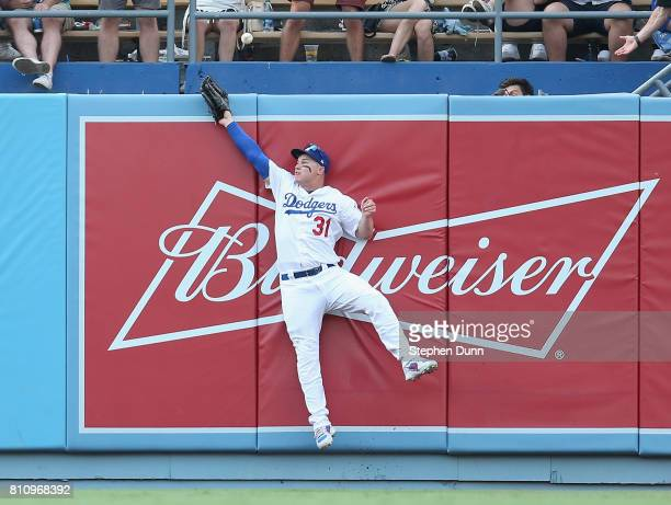 Center fielder Joc Pederson of the Los Angeles Dodgers jumps at the wall but can't reach a home run hit by Salvador Perez of the Kansas City Royals...