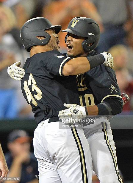 Center fielder John Norwood of the Vanderbilt Commodores celebrates with teammate Zander Wiel after hitting a solo home run for a 32 lead against the...