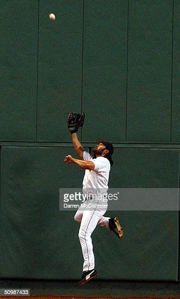 Center Fielder Johnny Damon of the Boston Red Sox makes a leaping catch in the sixth inning against the Minnesota Twins June 22 2004 at Fenway Park...
