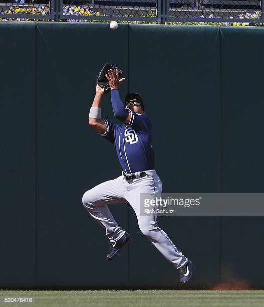 Center fielder Jon Jay of the San Diego Padres makes a catch on a ball hit by Cedric Hunter of the Philadelphia Phillies during the second inning at...