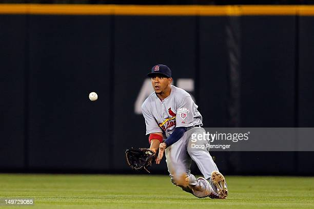 Center fielder Jon Jay of the St Louis Cardinals catches a fly ball for a put out against the Colorado Rockies at Coors Field on August 2 2012 in...