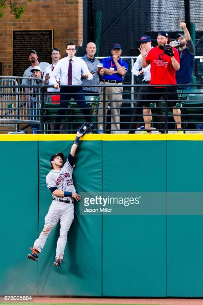 Center fielder Josh Reddick of the Houston Astros robs Jason Kipnis of the Cleveland Indians of a home run during the fifth inning at Progressive...