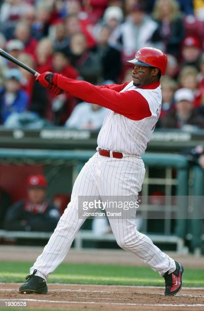 Center fielder Ken Griffey Jr. #30 of the Cincinnati Reds gets the first hit in the new Reds ball park against the Pittsburgh Pirates on opening day...