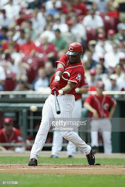 Center fielder Ken Griffey Jr of the Cincinnati Reds swings for the pitch during MLB game against the Cleveland Indians at Great American Ball Park...