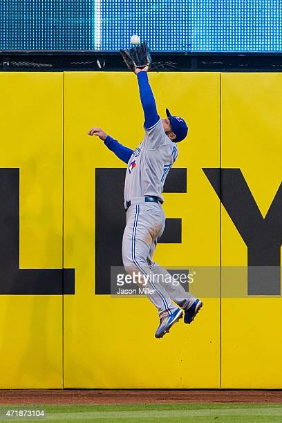 Center fielder Kevin Pillar of the Toronto Blue Jays catches a fly ball hit by Jason Kipnis of the Cleveland Indians during the fourth inning at...
