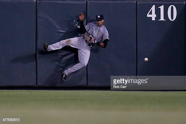 Center fielder Mason Williams of the New York Yankees misses a triple hit by Nolan Reimold of the Baltimore Orioles during the fifth inning at Oriole...