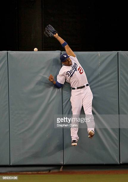 Center fielder Matt Kemp of the Los Angeles Dodgers can't reach a two run home run hit by Ian Stewart of the Colorado Rockies in the first inning on...