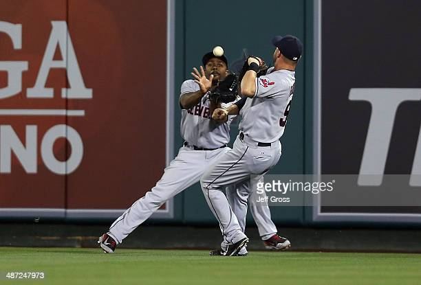 Center fielder Michael Bourn makes a catch before nearly colliding with right fielder Ryan Raburn on an ball hit by Ian Stewart of the Los Angeles...