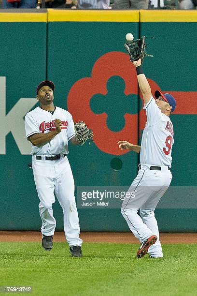 Center fielder Michael Bourn watches as right fielder Ryan Raburn of the Cleveland Indians catches a fly ball hit by Alex Rios of the Chicago White...