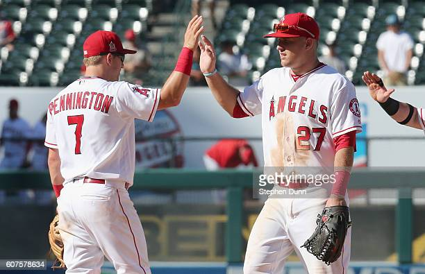 Center fielder Mike Trout and second baseman Cliff Pennington of the Los Angeles Angels of Anaheim celebrate after the game against the Toronto Blue...