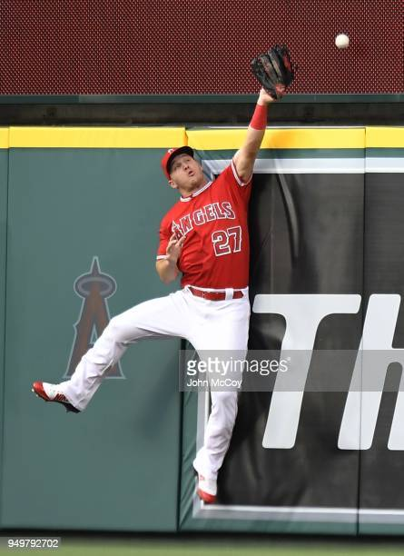 Center fielder Mike Trout of the Los Angeles Angels of Anaheim can not get to the home run ball hit by Brandon Belt of the San Francisco Giants in...