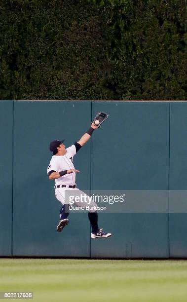 Center fielder Mikie Mahtook of the Detroit Tigers makes a leaping catch of a ball hit by Salvador Perez of the Kansas City Royals for the third out...