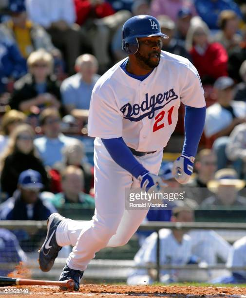 Center fielder Milton Bradley of the Los Angeles Dodgers runs after batting against the Florida Marlins during MLB Spring Training action on March 2,...