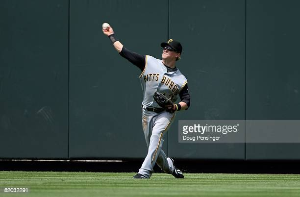 Center fielder Nate McLouth of the Pittsburgh Pirates fields a ball against the Colorado Rockies at Coors Field on July 20 2008 in Denver Colorado...