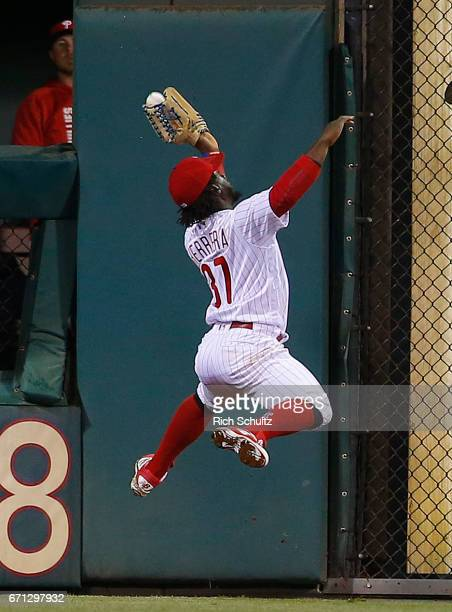 Center fielder Odubel Herrera of the Philadelphia Phillies makes a leaping catch on a ball hit by Jace Peterson of the Atlanta Braves during the...