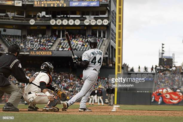 Center fielder Preston Wilson of the Florida Marlins hits a home run during the MLB game against the San Francisco Giants at Pacific Bell Park in San...