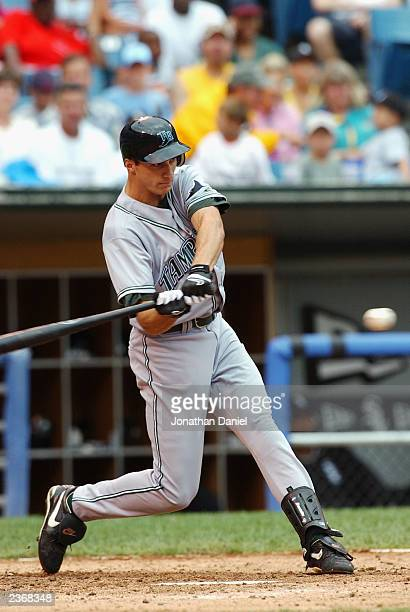 Center fielder Rocco Baldelli of the Tampa Bay Devil Rays swings at a Chicago White Sox pitch during the MLB game at U.S. Cellular Field on July 27,...