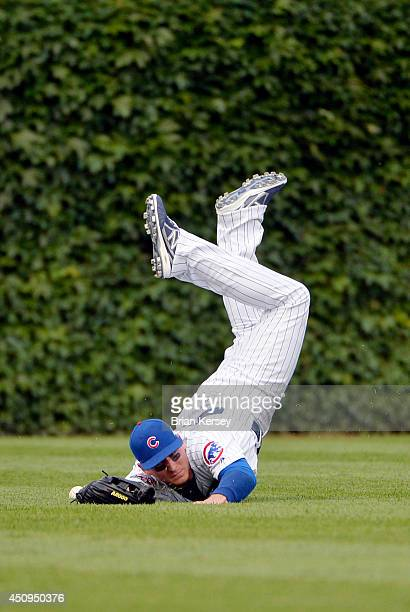 Center fielder Ryan Sweeney of the Chicago Cubs dives for and misses a single hit by Ike Davis of the Pittsburgh Pirates during the second inning at...