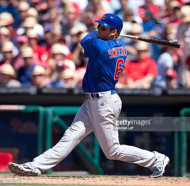 Center fielder Ryan Sweeney of the Chicago Cubs swings the bat against the Philadelphia Phillies on June 15 2014 at Citizens Bank Park in...