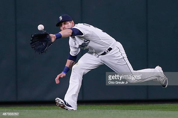 Center fielder Shawn O'Malley of the Seattle Mariners makes a running catch on a ball off the bat of Elvis Andrus of the Texas Rangers in the fifth...