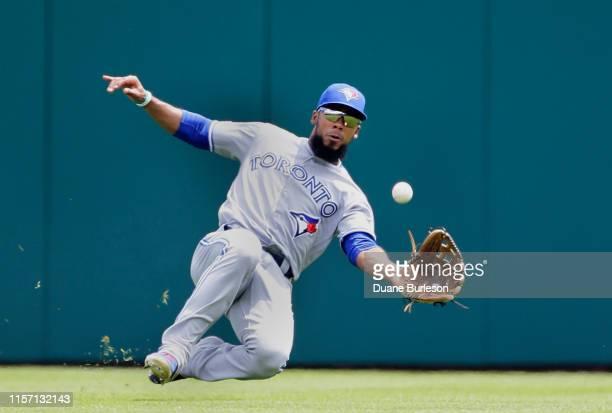 Center fielder Teoscar Hernandez of the Toronto Blue Jays makes a sliding catch of a fly ball hit by Nicholas Castellanos of the Detroit Tigers...