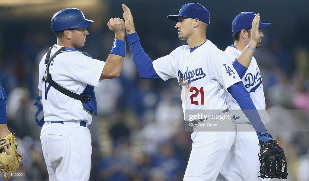 Center fielder Trayce Thompson #21 and catcher A.J. Ellis #17 of the Los Angeles Dodgers celebrate after the game against the Colorado Rockies at Dodger Stadium on July 2, 2016 in Los Angeles, California. The Dodgers won 6-1.