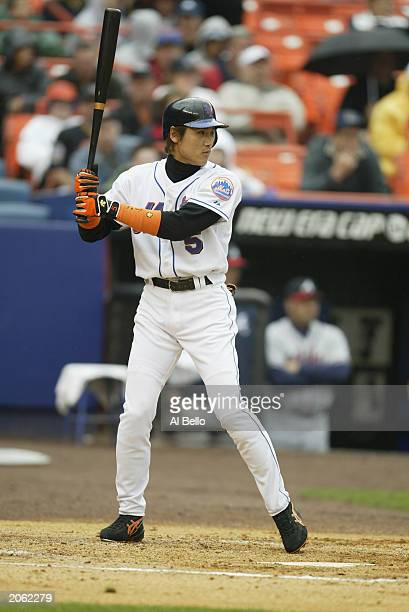 Center fielder Tsuyoshi Shinjo of the New York Mets waits for the pitch during the game against the Atlanta Braves on May 31 2003 at Shea Stadium in...