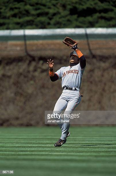 Center fielder Tsuyoshi Shinjo of the San Francisco Giants attempts to catch the ball during the MLB game against the Chicago Cubs at Wrigley Field...