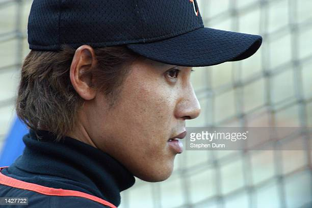 Center fielder Tsuyoshi Shinjo of the San Francisco Giants hangs around the batting cage before the MLB game against the Los Angeles Dodgers on...