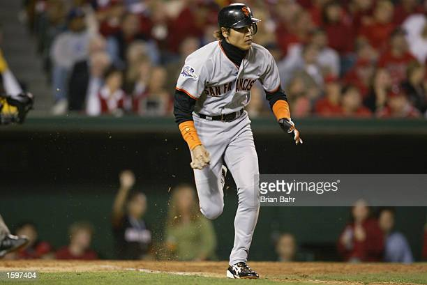 Center Fielder Tsuyoshi Shinjo of the San Francisco Giants heads to first base during game one of the World Series against the Anaheim Angelson...