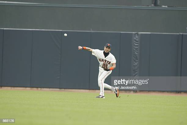 Center fielder Tsuyoshi Shinjo of the San Francisco Giants heaves a throw to the infield during the MLB game against the Philadelphia Phillies at Pac...