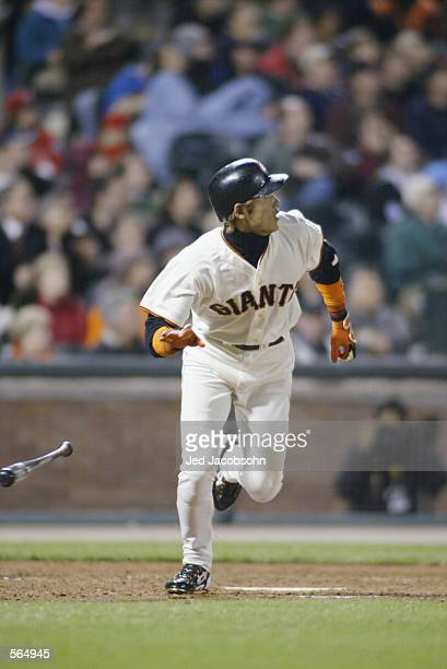 Center fielder Tsuyoshi Shinjo of the San Francisco Giants runs out of the batter's box during the MLB game against the Philadelphia Phillies at Pac...