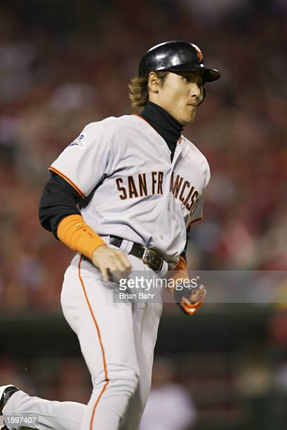 Center Fielder Tsuyoshi Shinjo of the San Francisco Giants runs to first base during game one of the World Series against the Anaheim Angels on...