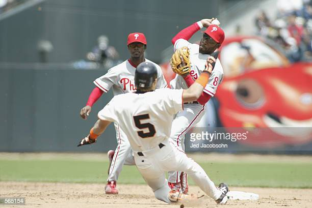 Center fielder Tsuyoshi Shinjo of the San Francisco Giants slides under second baseman Marlon Anderson of the Philadelphia Phillies during the MLB...