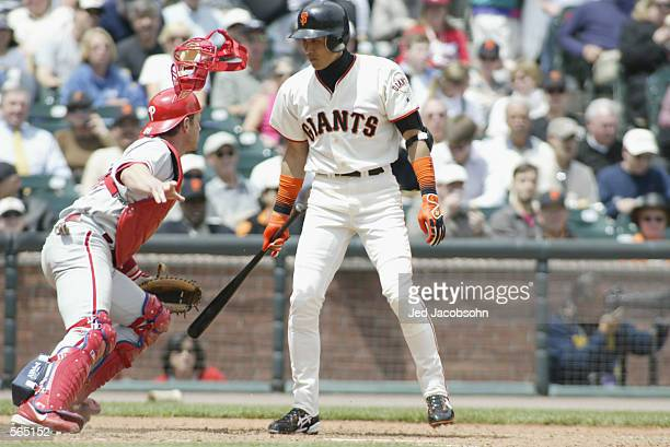 Center fielder Tsuyoshi Shinjo of the San Francisco Giants stands in the batter's box as catcher Mike Lieberthal of the Philadelphia Phillies chases...
