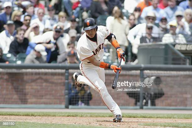 Center fielder Tsuyoshi Shinjo of the San Francisco Giants stumbles out of the batter's box during the MLB game against the Philadelphia Phillies at...
