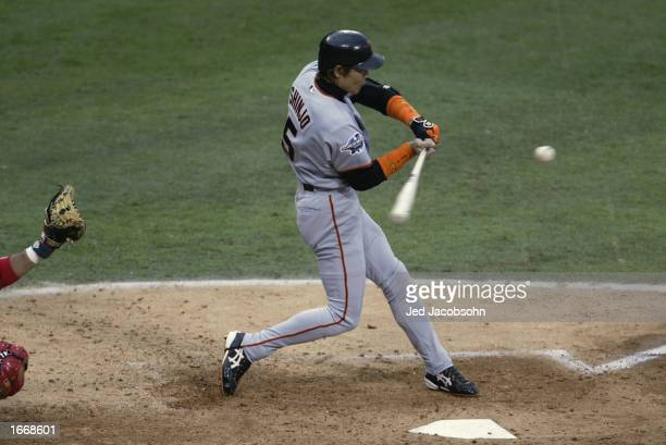 Center Fielder Tsuyoshi Shinjo of the San Francisco Giants swings at the pitch during game one of the World Series against the Anaheim Angels on...