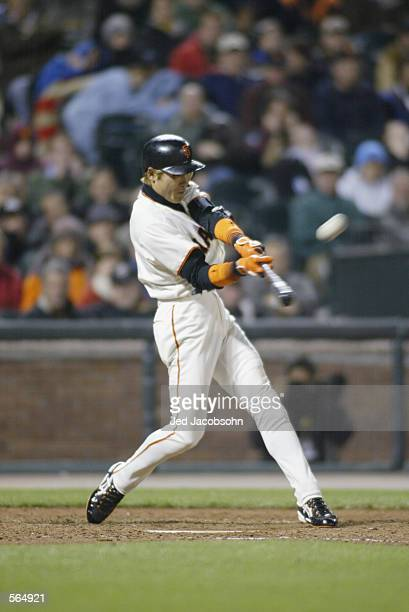 Center fielder Tsuyoshi Shinjo of the San Francisco Giants swings the bat during the MLB game against the Philadelphia Phillies at Pac Bell Park in...