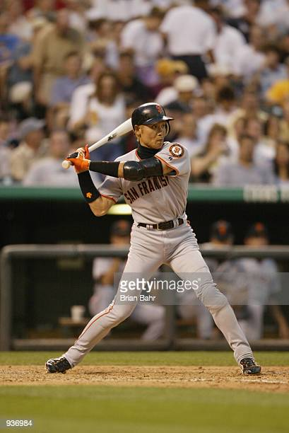 Center fielder Tsuyoshi Shinjo of the San Francisco Giants waits for the pitch during the MLB game against the Colorado Rockies on July 2 2002 at...