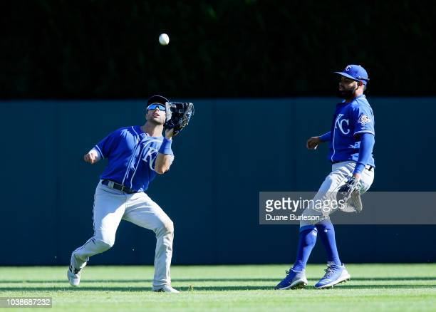 Center fielder Whit Merrifield of the Kansas City Royals catches a fly ball hit by Mikie Mahtook of the Detroit Tigers as right fielder Jorge...