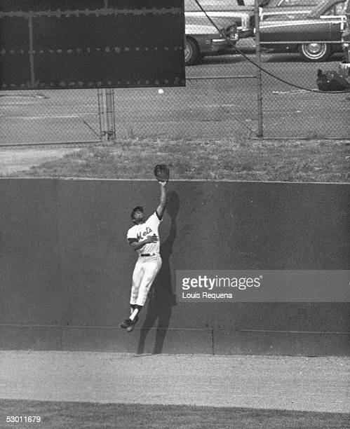 Center fielder Willie Mays of the New York Mets leaps high at the wall to rob Darrell Evans of the Atlanta Braves of a home run in the eight inning...