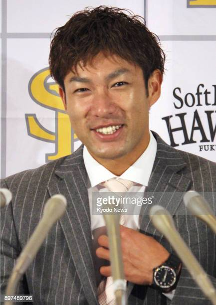 Center fielder Yuki Yanagita during a press conference at Yafuoku Dome in Fukuoka on Dec 23 after signing a threeyear deal with the SoftBank Hawks...