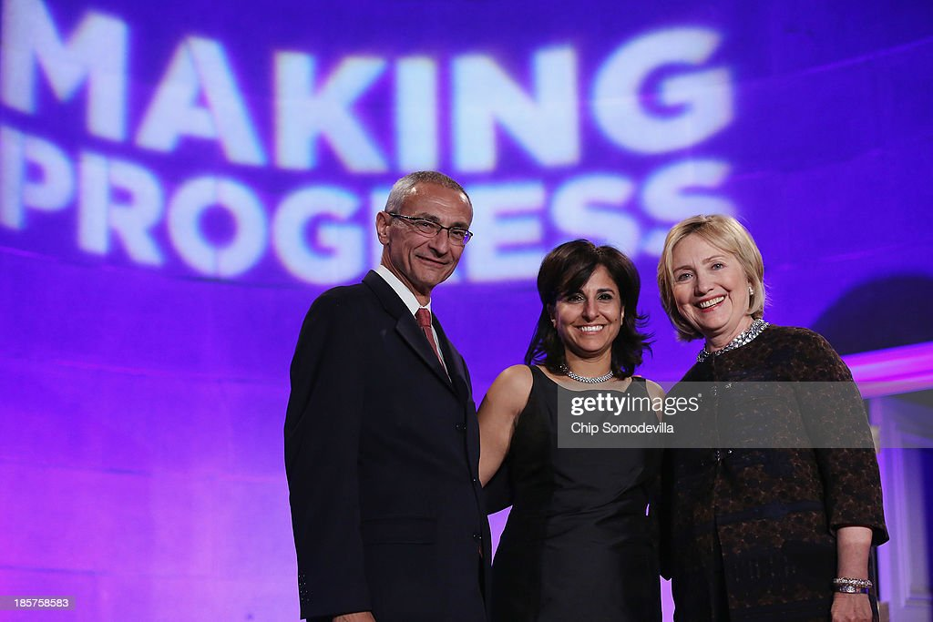 Center for American Progress co-founder John Podesta, center President Neera Tanden and former Secretary of State Hillary Clinton pose for photographs during a gala celebrating the 10th anniversary of the center wit co-founder John Podesta (L) at the Mellon Auditorium October 24, 2013 in Washington, DC. The center, a liberal public policy research and advocacy organization, is a think tank that rivals conservative policy groups, such as the Heritage Foundation and the American Enterprise Institute.