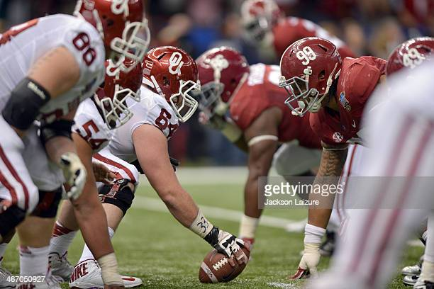 Center Gabe Ikard of the Oklahoma Sooners lines up across defensive lineman Brandon Ivory of the Alabama Crimson Tide during the BCS Sugar Bowl on...