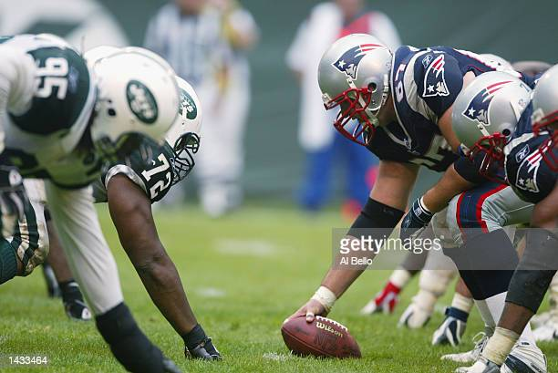 Center Grey Ruegamer of the New England Patriots flexes over the ball before the snap during the NFL game against the New York Jets on September 15,...