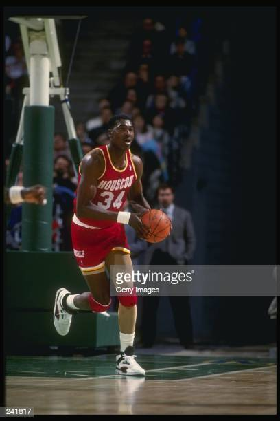 Center Hakeem Olajuwon of the Houston Rockets in action with the ball Mandatory Credit Allsport /Allsport