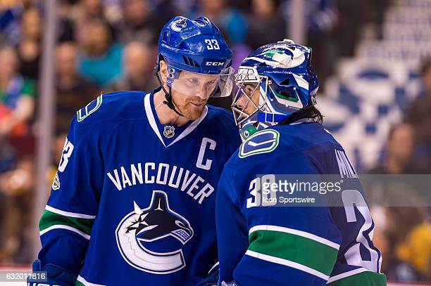 Center Henrik Sedin and Vancouver Canucks Goalie Ryan Miller talk during a stoppage in play against the Nashville Predators during their NHL game at...