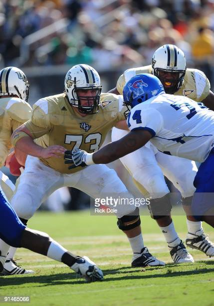 Center Ian Bustillo of the Central Florida Knights blocks against the Memphis Tigers at Bright House Networks Stadium on October 3, 2009 in Orlando,...