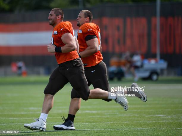 Center JC Tretter and guard Kevin Zeitler of the Cleveland Browns run sprints after a training camp practice on July 29 2017 at the Cleveland Browns...
