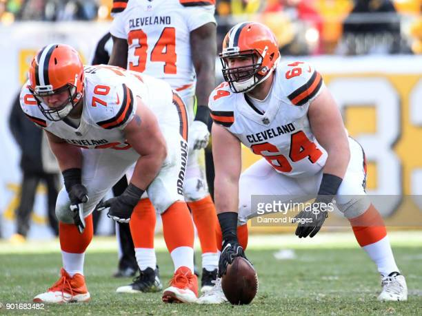 Center JC Tretter and right guard Kevin Zeitler of the Cleveland Browns await the snap from their positions in the third quarter of a game on...